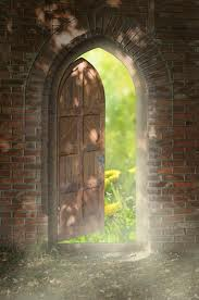 arched door in a wall opening on to a garden