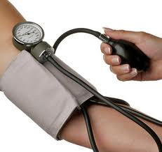 blood pressure cuff around an arm